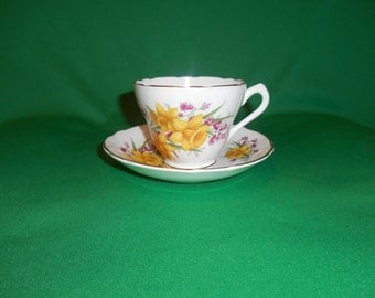 """One (1), 2 3/4"""" Footed, Bone China, Tea Cup & Saucer, from Grosvenor, in a Yellow Daffodil Pattern."""