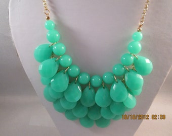 4 Row Bib Necklace with  Mint Green Teardrop Beads on a Gold Tone Chain