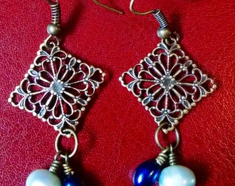 Antiqued brass and pearl earrings.