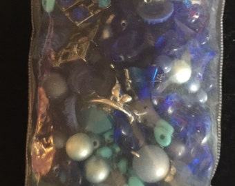 Bag of blue beads and broken vintage jewelry