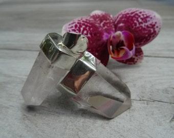 Clear or rose quartz on sterling silver frame.