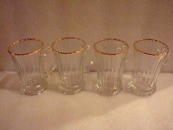 Items similar to Set Of Four Heavy Glass Gold Rimmed