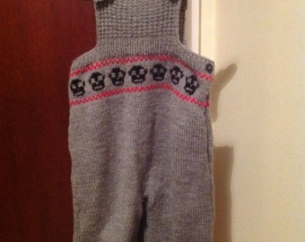 Knitted grey baby dungarees with black skulls, up to 12 months