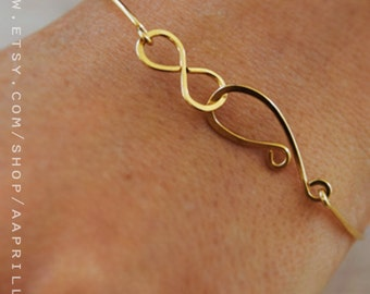 Infinity knot bangle, thin gold bangle bracelet, gold silver infinity bracelet, bridesmaid gift, thin  infinity bangle, infinity bracelet
