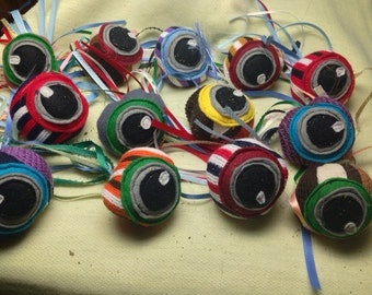 Eyeball catnip toys  made of upcycled scarf samples and ribbon.  3.00