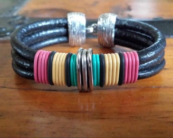 Triple Strand 5mm Black Leather Bracelet with Raspberry Pink Black Yellow Teal Rubber Bands Oval Silver Rings and Silver Hook Clasp