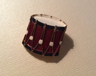 Enamled drum brooch, costume