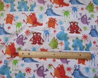 White with Multicolor Monsters Flannel Fabric by the yard