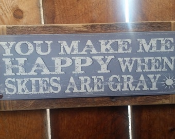 "Recycled wood framed ""You Make Me Happy When Skys are Gray"" street sign"