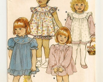 "A Back Button, Gathered Yoke, Short/Long Sleeve Dress, Pinafore, and Panties Pattern: Uncut - Toddler's Size 1, Breast 20"" • Butterick 3039"