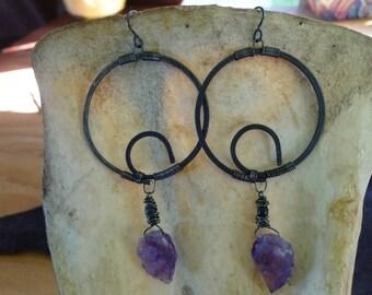 Hammered metal wire hoop amethyst earrings.
