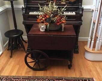 Antique cart wheel bar wooden table