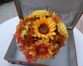 Fall bridal bouquet with sunflowers and trimmed with burlap
