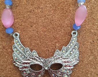 Feathered mask necklace