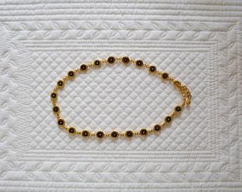 Black eyed gold necklace choker