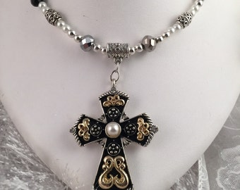 Beaded necklace with a very ornate cross pendant