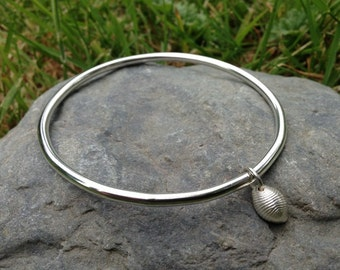 Cowrie shell bangle (medium) in sterling silver...