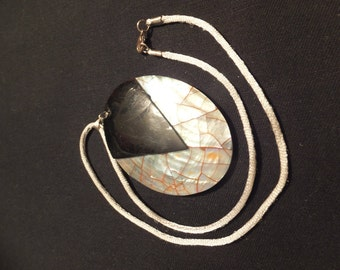 Large mother of pearl pendant on silver satin necklace