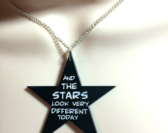 "Black star necklace..""and the stars look very different today"" Bowie lyrics Space Oddity"