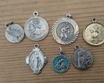 lot of seven religious charms/St.Christophers