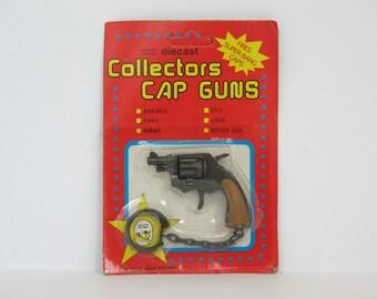 Key Chain Toy Cap Gun Colt Model  Unopened 1979 Die Cast Cap Gun