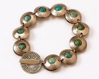 "Bronze Metal Bracelet - Circular Design 1/2"" with African Turquoise Beads"