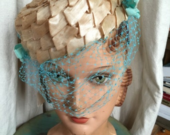 an Evelyn Varon pillbox straw hat with Turquoise veil replacement circa 1950s