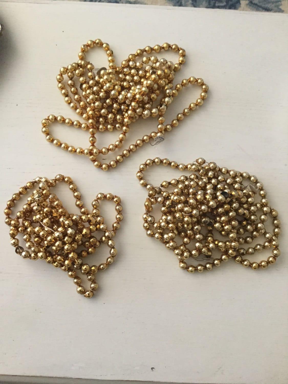 three vintage gold glass bead garlands