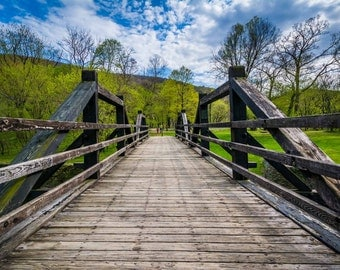 Wooden bridge over the Shenandoah Canal, in Harpers Ferry, West Virginia. | Photo Print, Stretched Canvas, or Metal Print.