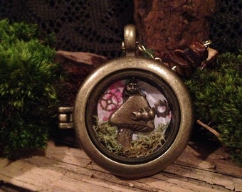 Wonderland pocket watch necklace on beaded chain of glass beads and swarovski crystals.