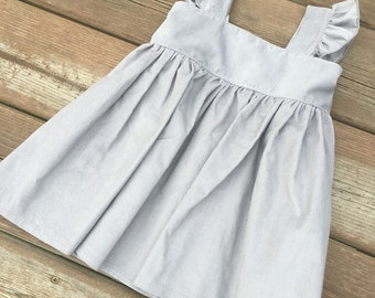Gray corduroy pinafore dress top with flutter sleeves for baby, toddler girls