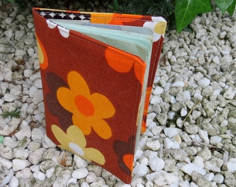 A passport cover.  Groovy retro flower power.  A fabric passport sleeve, made from an iconic 1960s cotton.
