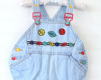 Vintage baby boy overalls. Blue overalls with sports balls on the chest. Gymboree sz 0-6 mo