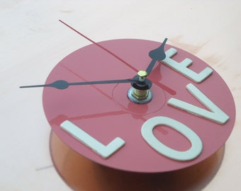 Pink wall clock, ideal for modern and stylish décor, small wall clock with back hook price on offer
