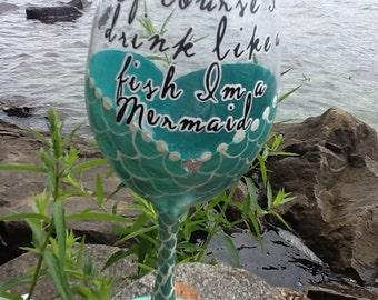 "New..Mermaid wine glass.""Of course I drink like a fish I'm a Mermaid""..pearlized bluish green painted glass with a little heart shape bling"