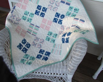 Modern, not-too-girlie,  teal, cream, blue, and pink baby girl quilt