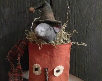 Fang, our wool felt mouse sitting inside a prim pumpkin pocket.