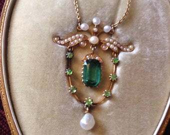 Edwardian gold pendant set with green garnet, peridot and seed pearls
