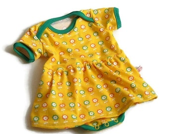 Baby dress with an integrated body of