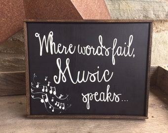 Where words fail, music speaks - hand painted music inspired sign - black and white