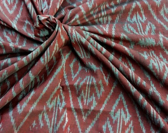 Handwoven Mudmee 100% Cotton from Thailand. Red and silver. 1.8 metres/ 2 yards