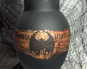 """Up-cycled glass bottle turned creepy Halloween decor!  """"Ash of Demon"""" urn to add to your potion bottle collection."""