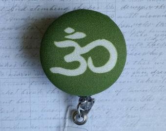 Green Om Badge Reel