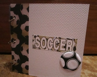 """Premade """"Soccer"""" scrapbook. Hand-crafted with wood pages, designer paper & embellishments. A unique and fun style!"""