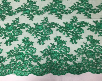 Green modern roses embroider and corded on a mesh lace -yard