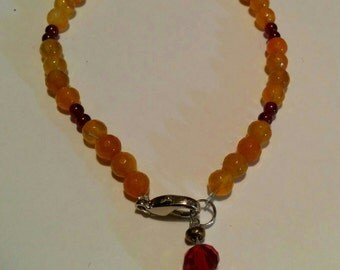 Handmade bracelet with amber and red crystals