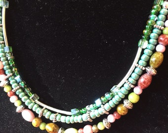 3 strand necklace with green colors