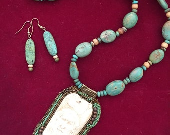 Hand carved bone with turquoise