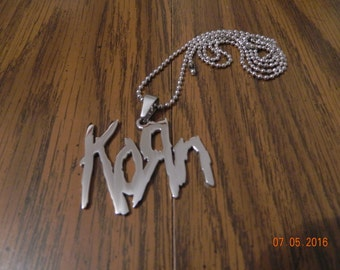 NEW- KORN 316 grade stainless steel pendant with a matching 30 inch ball chain