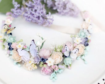 Necklace with flowers and butterfly